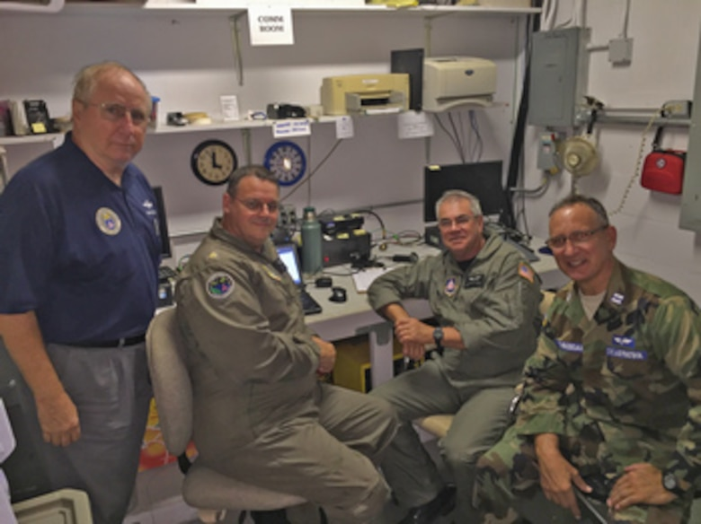 Emergency locator transmitter personnel (from left) Lt. Col. Carl Kretzer and Maj. Gary Stalnaker, mission pilots, and Capts. Richard Ross, mission observer, and Mark Thibodeau, safety officer, review a successful find. (Photo by CAP Lt. Col. Rodger Helton)