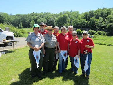Park Hosts Maria and Dennis Dube, Ted Robbins, Patrick Shull, Sharon Clark, Brenda Goessling and Brian Phelps assist Park Rangers Jean Hixson and Glenna Vitello pass out safety material before the derby.