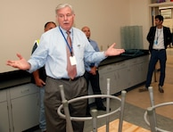 Mr. Lloyd Caldwell, Director of Military Programs tours one of the classrooms at Hanscom Middle School.