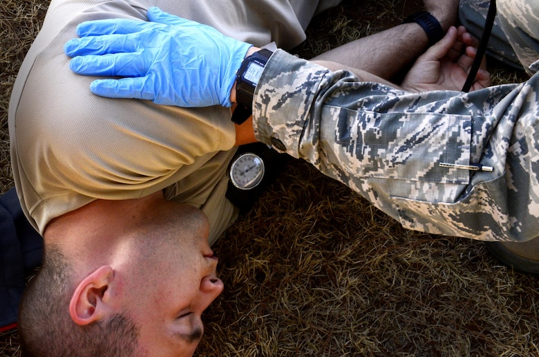 Emergency medical technicians assigned to Minot Air Force Base, N.D., treat a patient in a simulated hyperthermia scenario during the 2016 EMT Rodeo Aug. 26, 2016 at Cannon Air Force Base, N.M. Cannon's EMT Rodeo tests the skills of medical professionals from across the Air Force through a series of innovative, high-pressure scenarios. (U.S. Air Force photo by Tech. Sgt. Manuel J. Martinez)