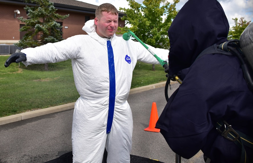 Staff Sgt. Joseph Kulczyk begins the decontamination process during a drill on Thursday, September 1, 2016. The drill was a simulation involving multiple agencies showcasing interoperability on base in case a radioactive incident were to take place. (U.S. Air Force photo by Staff Sgt. Richard Mekkri/released)