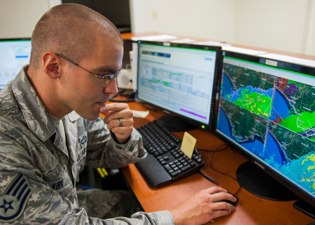 Staff Sgt. Andrew Kirk, 96th Weather Squadron, weather forecaster, watches the weather radar during Tropical Storm Hermine Sept. 1 at Eglin Air Force Base, Fla. Kirk evaluates thunderstorms for height, severity and their ability to produce lightning. This level of detailed observation ensures safe flight operations for military and commercial aircraft as well as the safety of all base units and personnel. The observations are performed every hour, every day and disseminated nationally and worldwide. (U.S. Air Force photo/Ilka Cole)