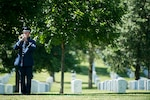 "A bugler with the U.S. Air Force plays Taps during the graveside service for 2nd. Lt. Malvin Greston ""Marvelous Mal"" Whitfield in Section 8 of Arlington National Cemetery, June 8, 2016, in Arlington, Va. Whitfield was a five-time Olympic medalist and a Tuskegee Airman."