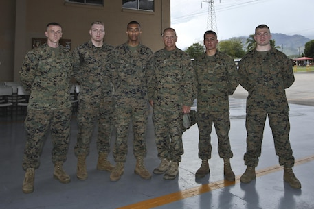 Commandant of the Marine Corps Gen. Robert B. Neller poses for a photo with Marine Security Guards at Marine Corps Embassy Honduras, Aug. 21, 2016.