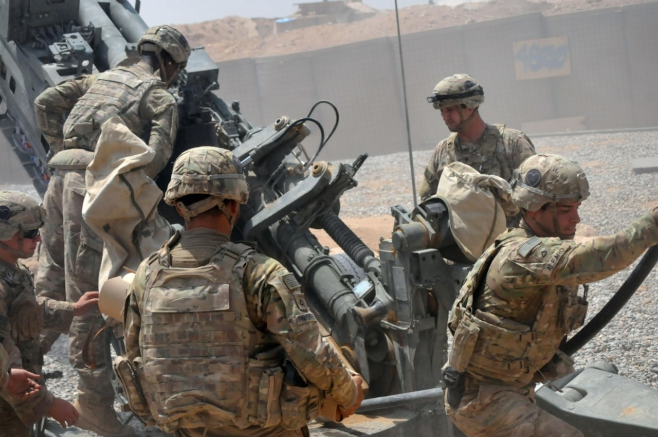 U.S. soldiers with Battery C, 1st Battalion, 320th Field Artillery Regiment, Task Force Strike, load a high-explosive round into an M777 howitzer at Kara Soar Base, Iraq, Aug. 7, 2016. Battery C Soldiers support the Combined Joint Task Force – Operation Inherent Resolve mission by providing indirect fire support for Iraqi security forces as they continue to combat the Islamic State of Iraq and The Levant and retake terrain. The assistance and support these soldiers provide demonstrate the commitment of the United States as part of a coalition of regional and international nations joined together to defeat ISIL and the threat they pose to Iraq, Syria, the region and the wider international community. Army photo by 1st Lt. Daniel Johnson