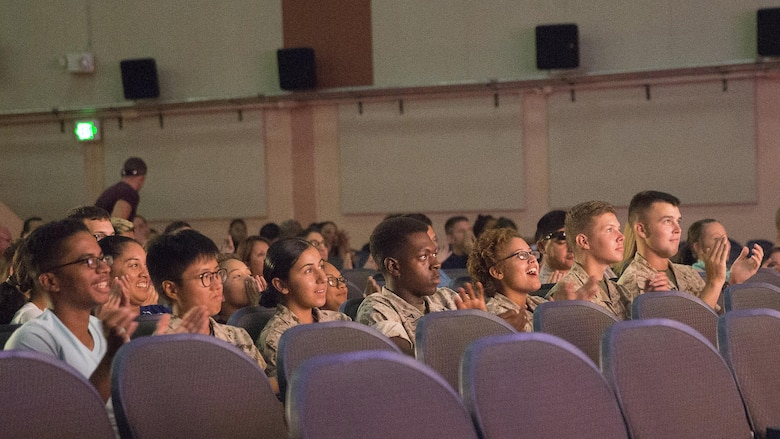 Marines in the audience applaud the participants of the Single Marines Program's 7th Annual Marines Got Talent Show at the Sunset Cinema, Aug. 12, 2016. The event is held to give service members the opportunity to show their talent with the rest of the Combat Center community. (Official Marine Corps photo by Cpl. Thomas Mudd/Released)