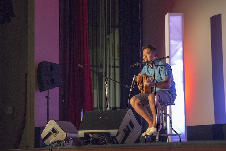 Seaman Anthony Roxas, corpsman, Naval Hospital Twentynine Palms, performs a compilation of songs from the 90's during the Single Marines Program's 7th Annual Marines Got Talent Show at the Sunset Cinema, Aug. 12, 2016. The event is held to give service members the opportunity to show their talent with the rest of the Combat Center community. (Official Marine Corps photo by Cpl. Thomas Mudd/Released)