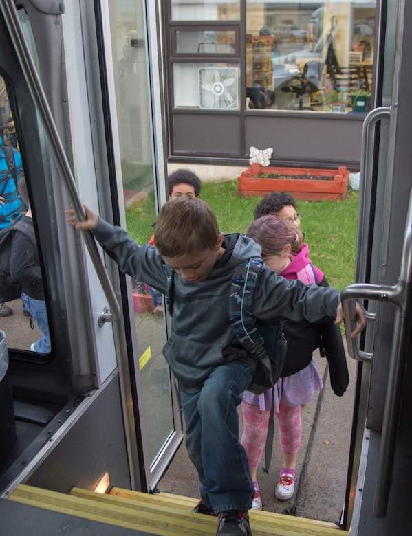 Ketchikan School Age Center students get on the bus on their way to school after being dropped off at the before-and-after school care programs for school-age children at Joint Elmendorf-Richardson, Alaska, Sept. 6, 2016. Ketchikan School Age Center roughly bused 150 students to and from school and provide before-and-after school care program for school-age children. (U.S. Air Force photo by Staff Sgt. Sheila deVera)