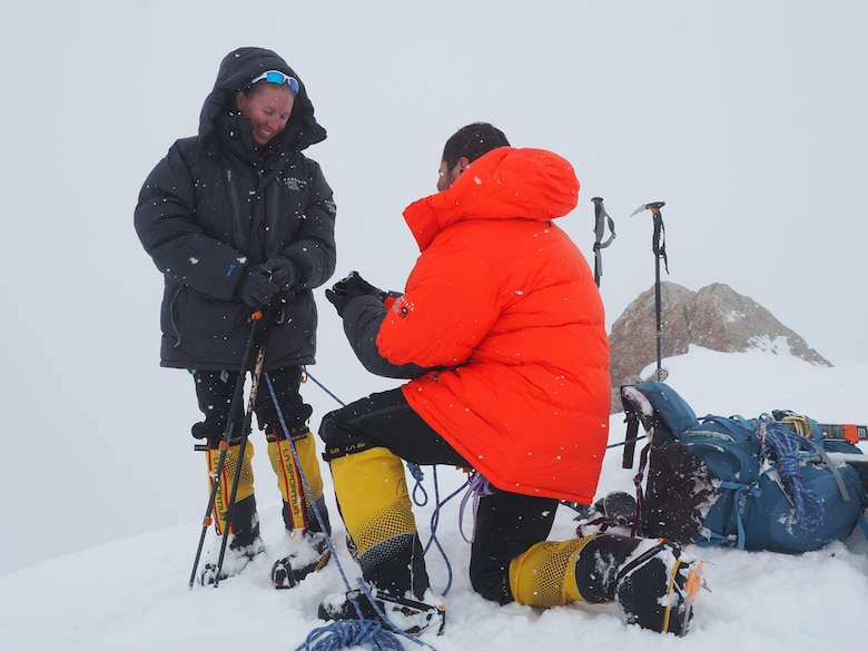 """Capt. Stephen Austria, project engineer in the USACE-Alaska District's Foreign Military Sales Program, proposes to his girlfriend and climbing partner, Rebecca Melesciuc, at the """"Edge of the World"""" overlook at 14,000-feet elevation on Denali."""