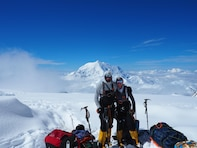 Capt. Stephen Austria, project engineer in the USACE-Alaska District's Foreign Military Sales Program, and fiancé and climbing partner, Rebecca Melesciuc, take a break from descending Denali, the tallest peak in North America, for a photo. Austria and Melesciuc climbed Denali this past summer to help raise Soldier suicide awareness.