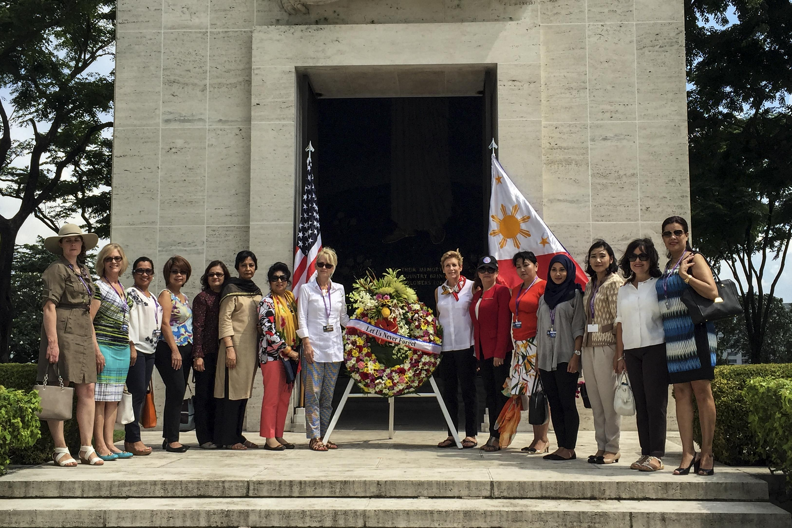 Ellyn Dunford, wife of Marine Corps Gen. Joe Dunford, and spouses of defense ministers present a wreath to honor fallen World War II U.S and Philippine service members at the Manila American Cemetery