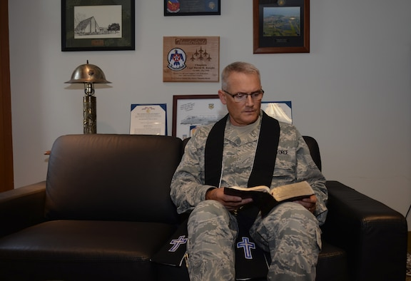 Chap. (Maj.) David Knight, the base chaplain assigned to the 28th Bomb Wing, reads his bible in his office at Ellsworth Air Force Base, S.D., August 31, 2016. During Knight's 14 years as an Air Force chaplain, he has been deployed four times, provided memorial services for approximately 80 troops killed in action and 1,600 patients who were wounded in action during his Operations Enduring Freedom and Iraqi Freedom deployments, as well as being named the 2005 Edwin Chess Award Winner (Company Grade Officer Chaplain of the Air Force). (U.S. Air Force photo by Airman 1st Class Denise M. Jenson)