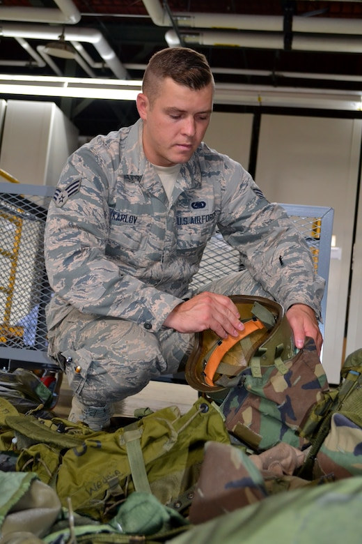 Senior Airman Igor Karlov, 111th Logistics Readiness Squadron supply technician, sorts through outdated military gear at Horsham Air Guard Station, Pa., Sept. 6, 2016. Karlov, part of the Pa. Air National Guard, was the first-ever Guardsman to receive The American Legion Spirit of Service Award in the 17 years it has been awarded to U.S. military members. (U.S. Air National Guard photo by Tech. Sgt. Andria Allmond)