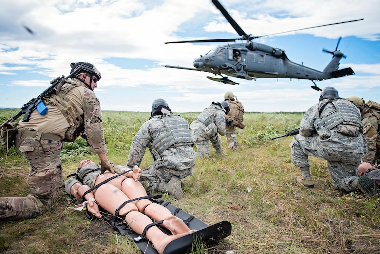 Members of the Alaska Air National Guard's 210th, 211th and 212th Rescue Squadrons and 176th Security Forces Squadron, along with the 163rd Security Forces Squadron from the California Air National Guard, participate in a mass-casualty exercise on Joint Base Elmendorf-Richardson, Alaska, on July 20, 2016. The scenario-based exercise involved security forces personnel who were conducting a patrol, when opposition forces ambushed their patrol, causing multiple casualties.