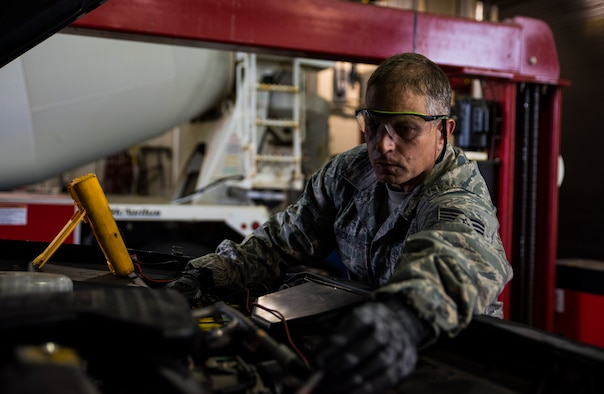 Tech. Sgt. Lloyd Hicks, general purpose vehicle mechanic supervisor, provides routine maintenance to a truck Sept. 1, 2016, at Ebbing Air National Guard Base, Fort Smith, Ark. Hicks has been selected as the Flying Razorback Spotlight for September. (U.S. Air National Guard photo by Senior Airman Cody Martin)