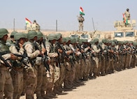 Peshmerga soldiers with 2nd Battalion, 1st Regional Guard Brigade, stand in formation during the Modern Brigade Course 2 graduation ceremony at the Menila Training Center, Iraq, July 28, 2016. Representatives from the U.S. Army, which provided equipment, and the Coalition trainers who taught the course attended the graduation to show their support for the battalion. The building partner capacity mission aims to increase the security capacity of local forces fighting the Islamic State of Iraq and the Levant. (U.S. Army photo by Sgt. Kalie Jones/Released)