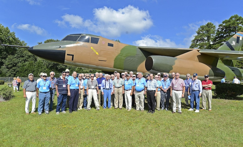 U.S. Air Force retired B-66 Destroyer aircraft crew members and pilots pose for a picture in front of a B-66 static display at Shaw Air Force Base, S.C., Aug. 30, 2016. The B-66 was a combat-ready light bomber that retained a three-man crew used by the USAF between the years of 1952 to 1966. (U.S. Air Force photo by Airman BrieAnna Stillman)