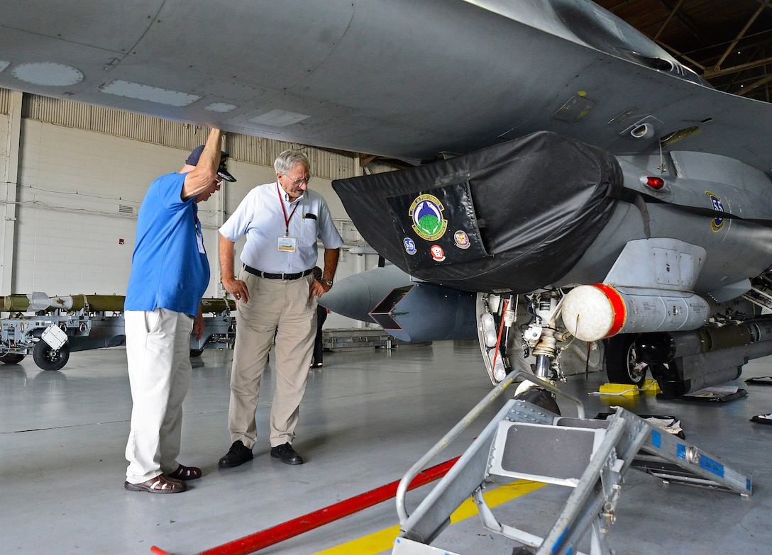 Two U.S. Air Force veterans take a closer look at a F-16 Fighting Falcon during a B-66 Destroyer reunion at Shaw Air Force Base, S.C., Aug. 30, 2016. Approximately 100 veterans from around the U.S. attended the reunion. (U.S. Air Force photo by Airman BrieAnna Stillman)