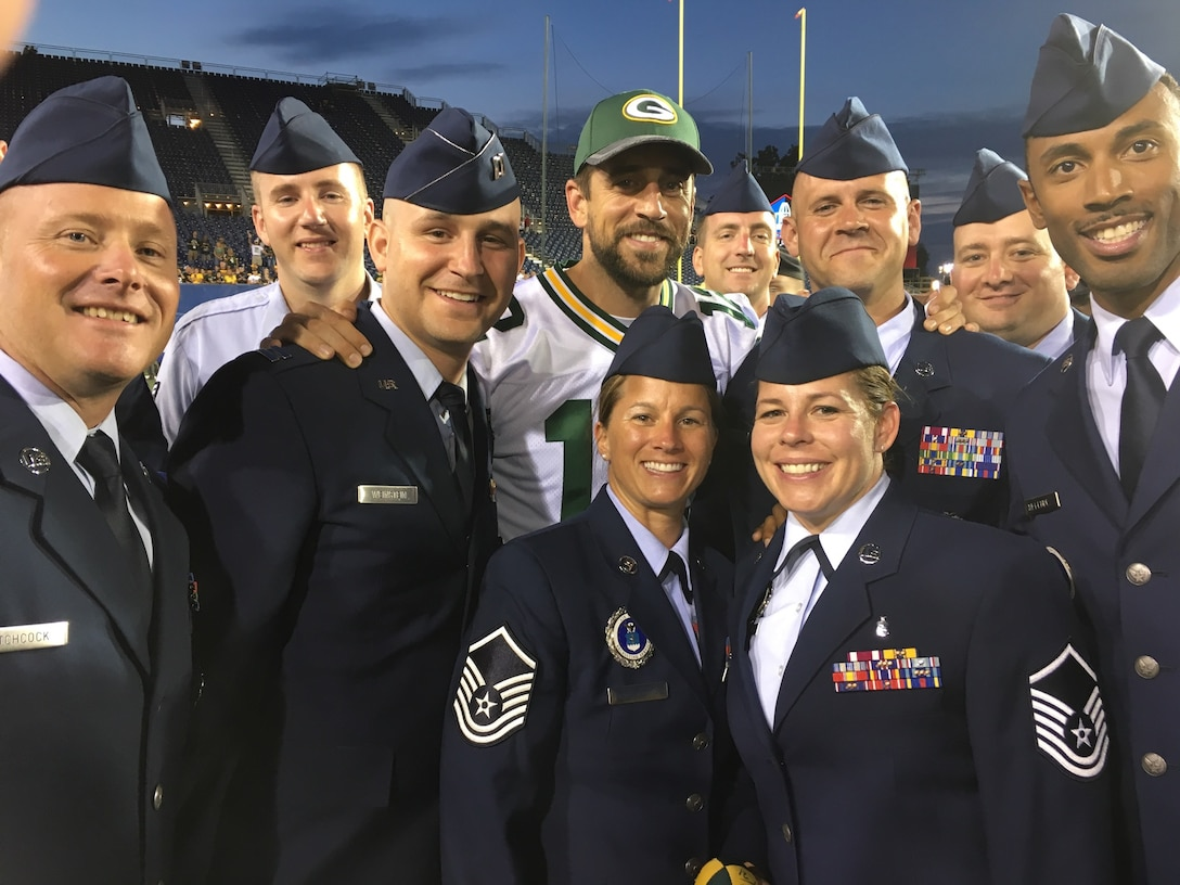 Members of the 311th and 318th Recruiting Squadrons take a photo with Aaron Rodgers, Green Bay Packers quarterback, at the National Football League Hall of Fame game in Canton, Ohio, Aug. 7. The game was cancelled, but many players and staff, to include Rodgers, were able to meet with military members to take pictures and sign autographs.  From left are: Master Sgt. Scott Hitchcock, Tech. Sgt. Daniel Santell, Capt. Curtis Weinstein, Rodgers, Master Sgt. Cori Branstetter, Staff Sgt. Kyle Gimble, Master Sgt. Nikki Davison, Master Sgt. Trent Branstetter, Tech. Sgt. Wayne Parson and Tech. Sgt. Sergio Melendez.