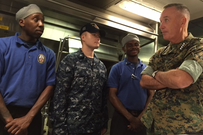 Marine Corps Gen. Joe Dunford, chairman of the Joint Chiefs of Staff, talks with sailors as he visits the USS Barry in Yokosuka, Japan, Sept. 7, 2016. The Barry, a guided-missile destroyer, is deployed in the 7th Fleet area of operations to support stability and security missions in the Indo-Asia-Pacific region. DoD photo by Lisa Ferdinando