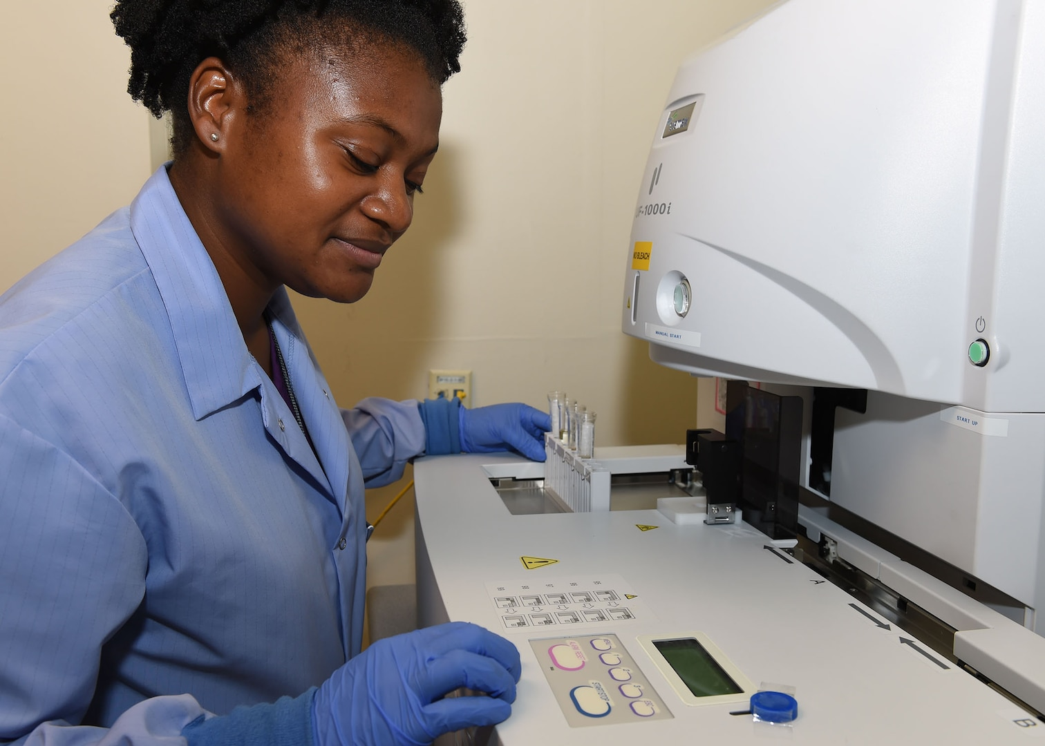 Hope Blanding, a 59th Diagnostics and Therapeutics Squadron medical lab technician, uses a Sysmex UF-1000i to run a microscopic analysis on samples in the Wilford Hall Ambulatory Surgical Center main lab, August 16. Devices like the Sysmex help to increase the accuracy and speed when processing sample for Science and Technology research projects. (U.S. Air Force photo/Tech. Sgt. Christopher Carwile/Released)