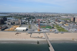 Sand replenishment work taking place on Coney Island Beach, New York.