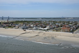 Sand replenishment work taking place on Rockaway Beach, New York.