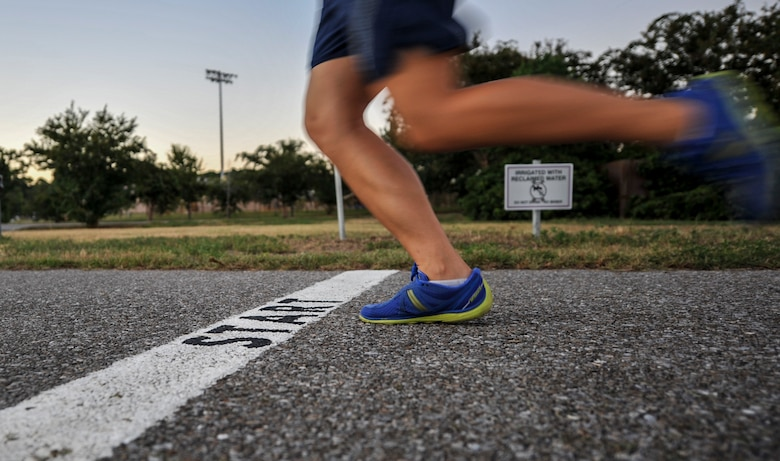 Senior Airman Rebecca Chamberlain, a paralegal with the 1st Special Operations Wing Legal Office, sprints on a track at Hurlburt Field, Fla., Aug. 30, 2016. Chamberlain is scheduled to participate in the half-marathon during the 20th Annual Air Force Marathon, Sept. 17, at Wright-Patterson Air Force Base, Ohio, as a member of the Air Force Special Operations Command's team. (U.S. Air Force photo by Airman 1st Class Joseph Pick)