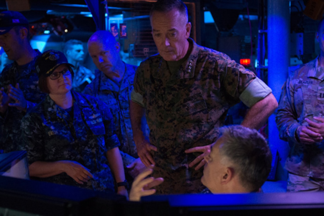 Marine Corps Gen. Joe Dunford, chairman of the Joint Chiefs of Staff, speaks with crew members aboard the Arleigh Burke-class guided missile destroyer USS Barry in Yokosuka, Japan, Sept. 7, 2016. DoD photo by Army Sgt. James K. McCann