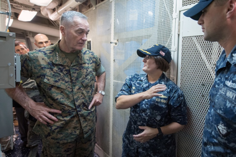 Navy Cmdr. Jennifer Eaton, commanding officer of the USS Barry, an Arleigh Burke-class guided missile destroyer, introduces Marine Corps Gen. Joe Dunford, chairman of the Joint Chiefs of Staff, to a crew member during a visit aboard the ship in Yokosuka, Japan, Sept. 7, 2016. DoD photo by Army Sgt. James K. McCann