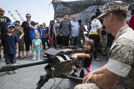 U.S. Marine Cpl. Jacob Kikta, machine gunner with Weapons Company, 3rd Battalion, 5th Marine Regiment, teaches children about the MK-19 Grenade Launcher, during a static display demonstration at Los Angeles Fleet Week in San Pedro, Calif., Sept. 4, 2016. L.A. Fleet Week is an event designed to showcase the capabilities of the Navy-Marine Corps team to L.A. residents, and an opportunity for members of the sea services to meet and thank the community for its support. (U.S. Marine Corps photo by Sgt. Rick Hurtado)