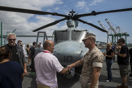 U.S. Marine Gunnery Sgt. Nathan Hanley, squadron gunnery sergeant for Marine Light Attack Helicopter Squadron 369, meets and greets members of the Los Angeles community and surrounding areas during a static display demonstration at Los Angeles Fleet Week in San Pedro, Calif., Sept. 4, 2016. L.A. Fleet Week is an event designed to showcase the capabilities of the Navy-Marine Corps team to L.A. residents, and an opportunity for members of the sea services to meet and thank the community for its support. (U.S. Marine Corps photo by Sgt. Rick Hurtado)