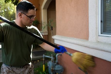 Lance Cpl. Jason Reed, an administration specialist with Marine Light Attack Helicopter Squadron 369, helps clean living facilities at the United States Veterans Initiative, a nonprofit organization that helps homeless veterans, Sept. 2, 2016, in Long Beach, Calif. Marines, Sailors and Coast Guardsmen, visited the facility where hundreds of homeless veterans live and receive assistance and care. The visit was one of many community service projects that took place during the first Los Angeles Fleet Week. (U.S. Marine Corps photo by Sgt. Rick Hurtado)