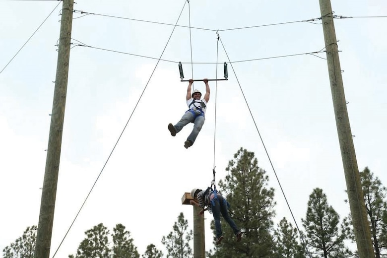 Trying to navigate a rope obstacle course at the Manzano Mountain Retreat, a pair of challengers swing through the air. Outdoor Recreation is leading a ropes course Sept. 17. (Courtesy photo)