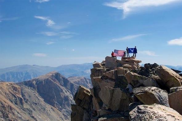 Airmen reach the summit of Granite Peak in Montana after a climb of more than 7,000 feet Aug. 30. They completed this task after three days as part of the U.S. Air Force 50 Summit Challenge, a group that was established in May, 2013. (Courtesy photo)