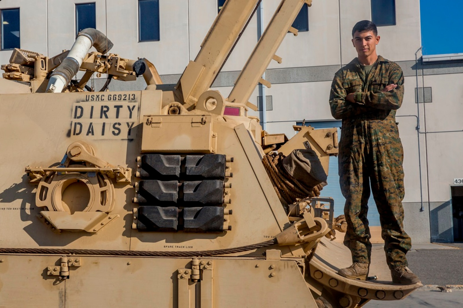Cpl. Calletano Jimenez stands on the M88A2 Hercules Recovery Vehicle he maintains at Camp Pendleton, Calif., Aug, 31, 2016. Jimenez is a tank mechanic with 1st Maintenance Battalion, Combat Logistics Regiment 15, 1st Marine Logistics Group who was recently awarded the Maintenance Marine of the Year Award by the Ground Ordnance Maintenance Association for his outstanding achievements in maintenance of military equipment and weapon systems. (U.S. Marine Corps photo by Lance Cpl. Kyle McNan/released)