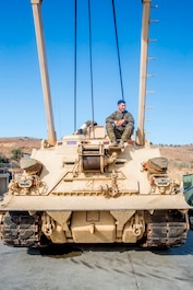 Cpl. Calletano Jimenez sits atop the M88A2 Hercules Recovery Vehicle he maintains at Camp Pendleton, Calif., Aug, 31, 2016. Jimenez is a tank mechanic with 1st Maintenance Battalion, Combat Logistics Regiment 15, 1st Marine Logistics Group who was recently awarded the Maintenance Marine of the Year Award by the Ground Ordnance Maintenance Association for his outstanding achievements in maintenance of military equipment and weapon systems. (U.S. Marine Corps photo by Lance Cpl. Kyle McNan/released)