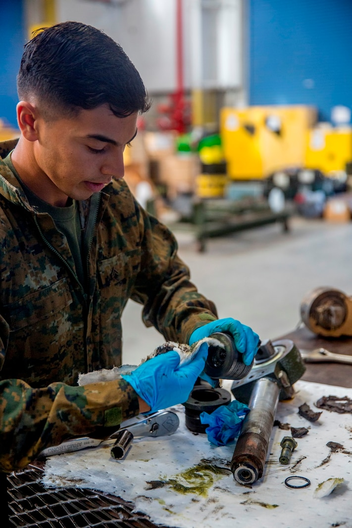 Cpl. Calletano Jimenez in his workshop at Camp Pendleton, Calif., Aug, 31, 2016. Jimenez is a tank mechanic with 1st Maintenance Battalion, Combat Logistics Regiment 15, 1st Marine Logistics Group who was recently awarded the Maintenance Marine of the Year Award by the Ground Ordnance Maintenance Association for his outstanding achievements in maintenance of military equipment and weapon systems. (U.S. Marine Corps photo by Lance Cpl. Kyle McNan/released)