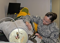 Staff Sgt. Julie Orellana, 9th Physiological Support Squadron full pressure suit technician, inspects and repairs the weave net on a full pressure suit Aug. 31, 2016, at Beale Air Force Base, California. The weave net helps the suit maintain its shape and stops it from over expanding. (U.S. Air Force photo/Airman Tristan D. Viglianco)
