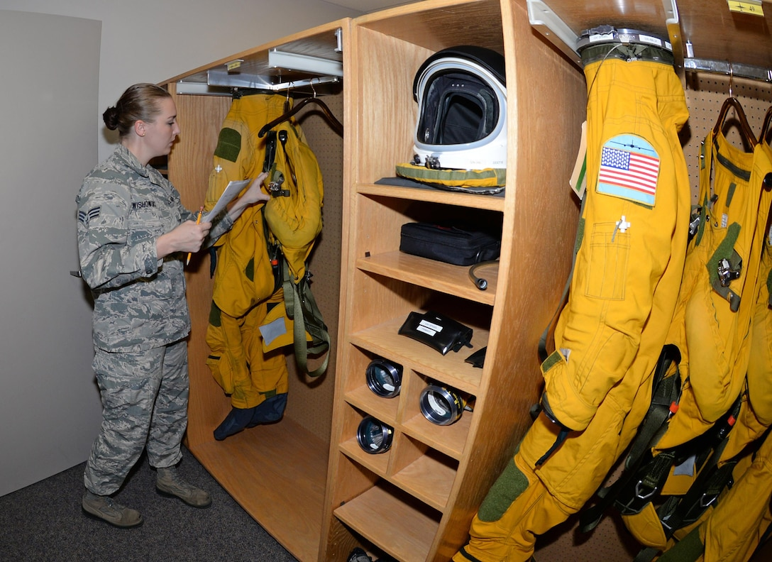 Senior Airman Kaylee Wishowski, 9th Physiological Support Squadron full pressure suit technician, reviews the maintenance completed on a full pressure suit and ensures it is ready for the pilots to wear September 7, 2016, at Beale Air Force Base, California. The 9th Physiological Support Squadron Airmen deploy to forward operating locations worldwide in support of the U-2 mission. (U.S. Air Force photo/Airman Tristan D. Viglianco)