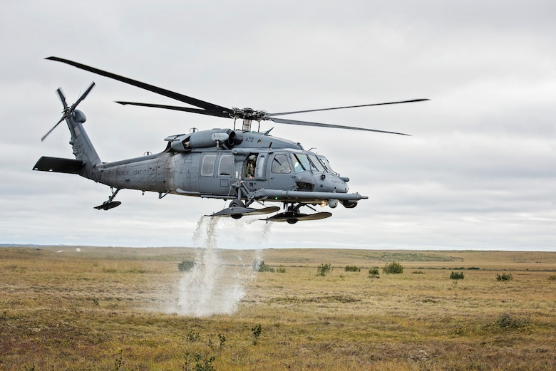 An HH-60 Pave Hawk helicopter from the 210th Rescue Squadron takes off from the tundra after loading simulated casualties during exercise Arctic Chinook, near Kotzebue, Alaska, August 24. Arctic Chinook is a joint U.S. Coast Guard and U.S. Northern Command sponsored exercise which focuses on multinational search and rescue readiness to respond to a mass rescue operation requirement in the Arctic. (U.S. Air National Guard photo by Staff Sgt, Edward Eagerton/released)