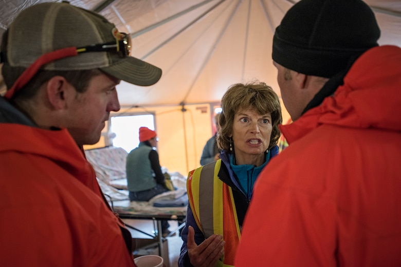 U.S. Sen. Lisa Murkowski talks with pararescuemen from the 212th Rescue Squadron, Alaska Air National Guard, while she visits a patient reception area at the Ralph Wien Memorial Airport in Kotzebue, Alaska, Aug. 24, during exercise Arctic Chinook. Arctic Chinook is a joint U.S. Coast Guard and U.S. Northern Command sponsored exercise which focuses on multinational search and rescue readiness to respond to a mass rescue operation requirement in the Arctic. (U.S. Air National Guard photo by Staff Sgt, Edward Eagerton/released)
