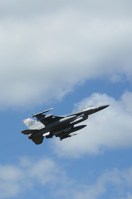 An F-16 Fighting Falcon flies past the tower at Hardwood Range, near Finley, Wis., during the 2016 Northern Lightning Exercise at Volk Field Air National Guard Base, Camp Douglas, Wis., Aug. 31, 2016. More than 1,000 service members and both fourth and fifth generation aircraft had the opportunity to train together during the two-week exercise. (U.S. Air National Guard photo by Staff Sgt. Andrea F. Rhode)