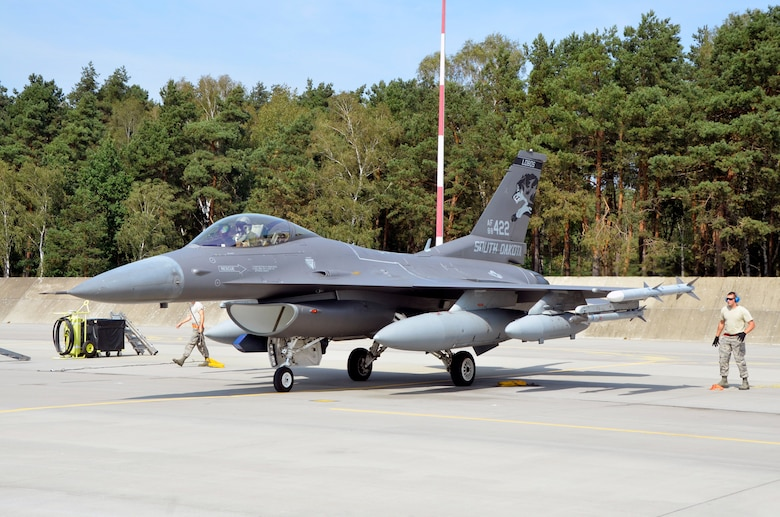 Lask Air Base, Poland -- An F-16 Fighting Falcon from the South Dakota Air National Guard, 114th Fighter Wing parks at Lask Air Base, Sept. 3. More than 100 members of the unit are deployed in support of Aviation Detachment 16-4, a bilateral training exercise between the U.S. and Polish forces. (U.S. Air National Guard photo by Capt. Amy Rittberger/Released)