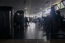 U.S. Air Force Airmen work out with limited electricity at the fitness center at Incirlik Air Base, Turkey, July 21, 2016. Due to a temporary loss of commercial power, some facilities had to continue operations, including the base's fitness center until power was completely restored. (U.S. Air Force photo by Senior Airman John Nieves Camacho)