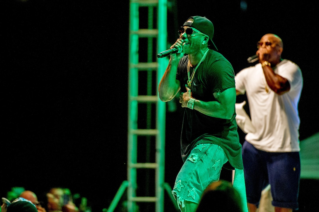 Nelly performs a song at Osan Air Base, Republic of Korea, Sept. 3, 2016. Nelly put on a one-night concert for members of Team Osan and their families. (U.S. Air Force photo by Staff Sgt. Jonathan Steffen)