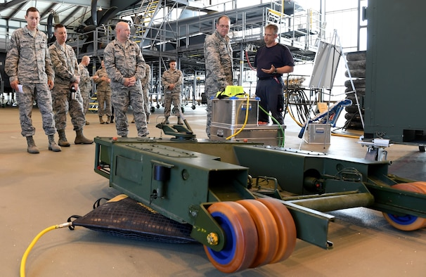Tino Weichel, 86th Maintenance Squadron aero repair aircraft mechanic describes capabilities of the 86th Maintenance Group to Brig. Gen. Richard G. Moore, Jr., 86th Airlift Wing commander, during a demonstration Aug. 31, 2016 at Ramstein Air Base, Germany. The 86th MXG maintains U.S. Air Forces in Europe's only assigned distinguished visitor airlift and 24/7 aeromedical evacuation operations. (U.S. Air Force photo/Senior Airman Tryphena Mayhugh)