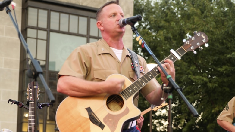 Col. Mike Corrado performs for Marines and Nashville, Tenn. residents during the opening ceremony of Marine Week Nashville, Sept. 7, 2016. Marine Week celebrates the contributions of local Marines whose service to our nation has protected and preserved our way of life for hundreds of years.