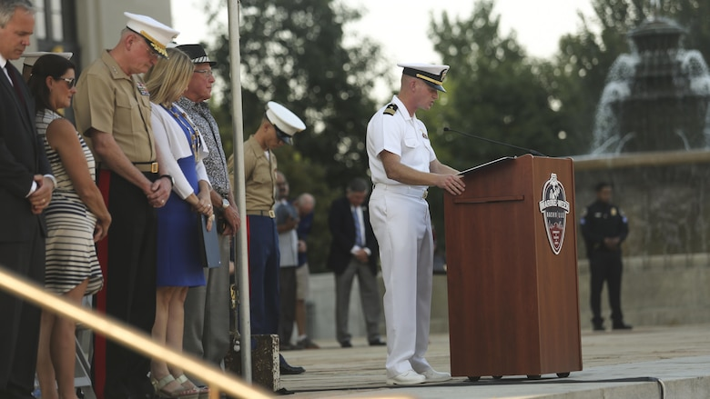 Navy Lt. Cdr. Bryan Davenport, center, the chaplain of Special Purpose Marine Air Ground Task Force - Nashville, leads a prayer during the opening ceremony of Marine Week Nashville in Nashville, Tenn., Sept. 7, 2016. More than 800 Marines are participating in Marine Week to give the citizens of the greater Nashville area the opportunity to meet the individual Marines and celebrate community, country and Corps.