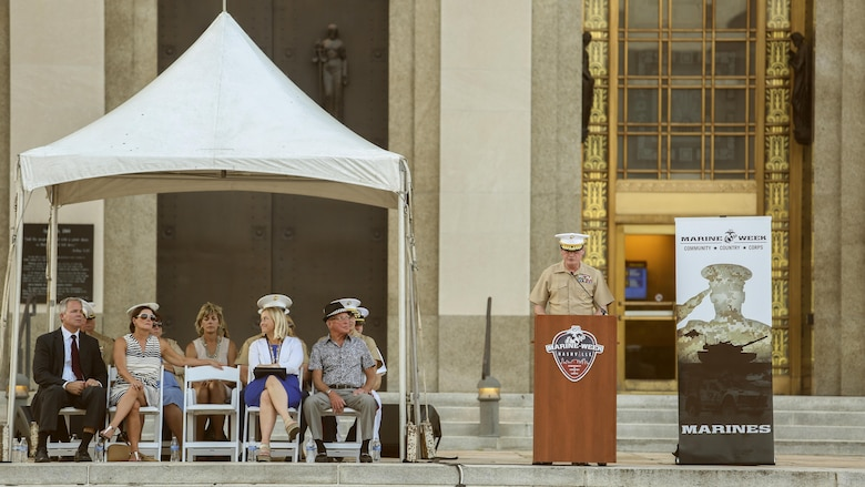 Lt. Gen. James B. Laster, right, the director of Marine Corps staff, offers remarks during the opening ceremony of Marine Week Nashville, Sept. 7, 2016. Marine Week celebrates the contributions of local Marines whose service to our nation has protected and preserved our way of life for hundreds of years.
